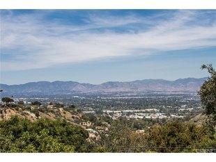 <div>14359 Mulholland Dr</div><div>Los Angeles, California 90077</div>