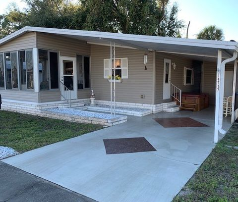 14717 Shadowwood Blvd, Hudson, FL 34667 on nv mobile home parks own land, log cabins with land, new construction with land, mobile homes on land, buildings with land, really nice houses with land,