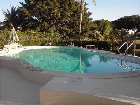 253 N Country Club Dr, Atlantis, FL 33462