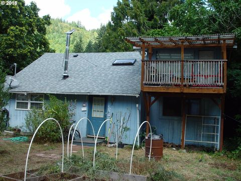 Photo of 12777 Sutherland Rd, Swisshome, OR 97480