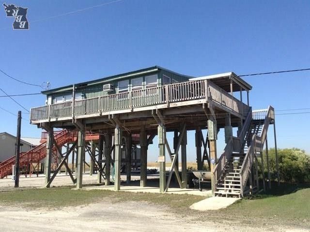 7986 redfish st cocodrie la 70344 home for sale real for Fishing camps for sale in louisiana