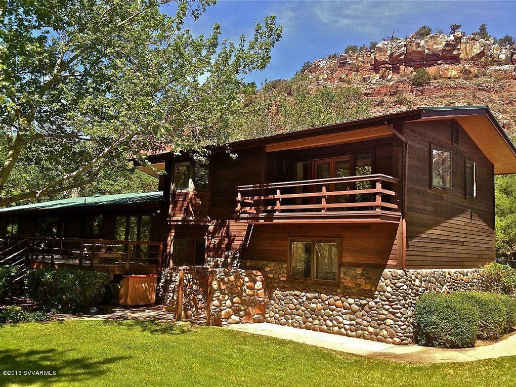 the hot cliffside cliffs getaway towering az rental canyon tub sit cabins under sedona in cabin