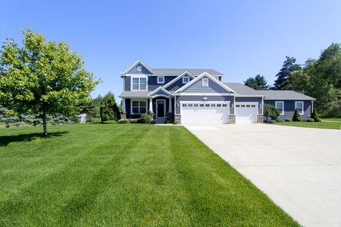 Photo of 7943 9 Mile Rd Ne, Rockford, MI 49341. House for Sale