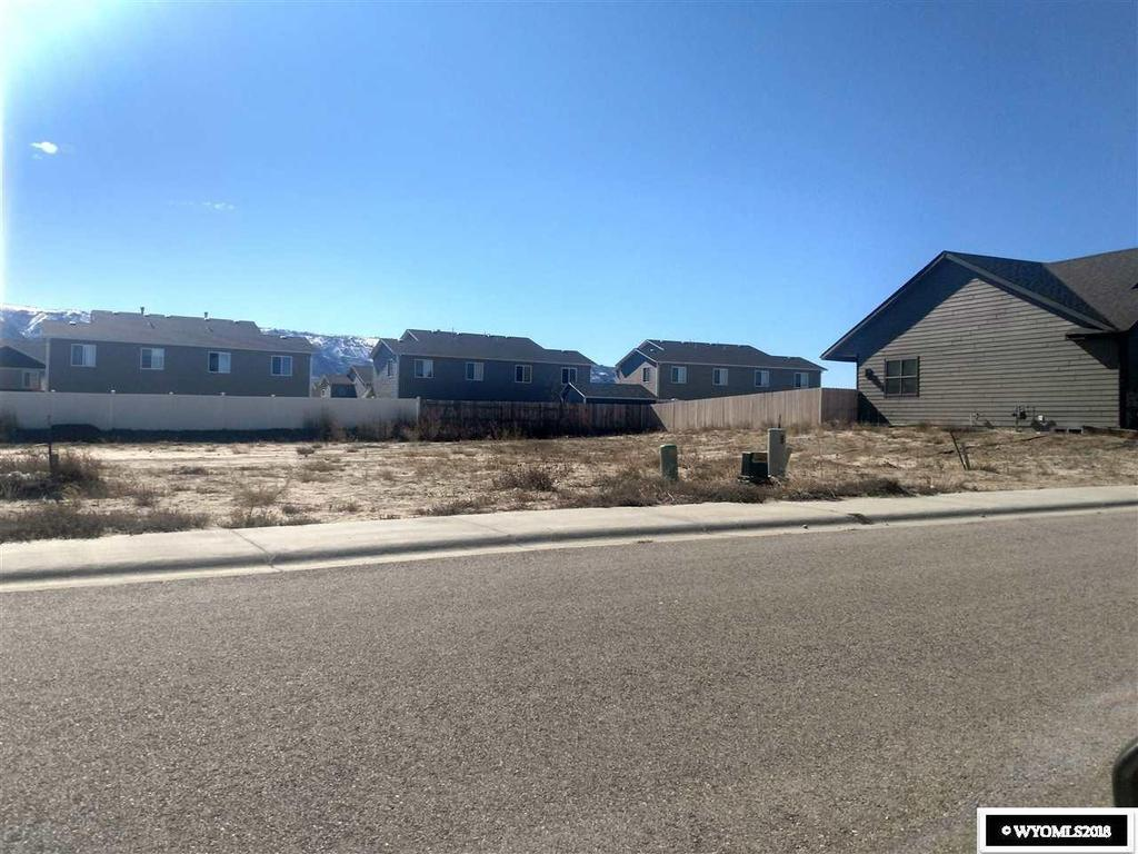 Road view featured at 6949 Rogue River Rd, Casper, WY 82604