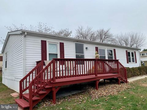 82 Chesapeake Est, Thomasville, PA 17364 on red houses, red decks, red siding,