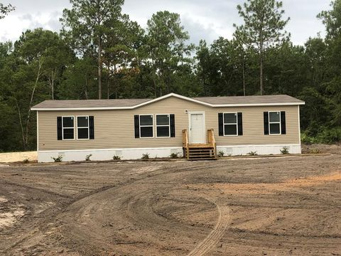 Photo of 305 Dogwood Acres Rd, Jesup, GA 31545