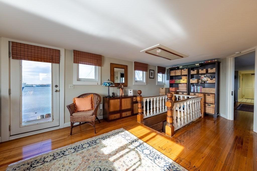 Living room featured at 50 Fort St Unit 1, Fairhaven, MA 02719