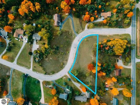 Photo of 7085 S Whispering Hills Dr, Traverse City, MI 49684