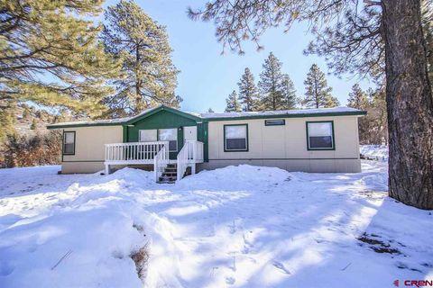 58 Bob White Dr, Pagosa Springs, CO 81147 Native Rock Log Home Designs on rock churches, rock lake homes, rock lake cabins, rock and log house,