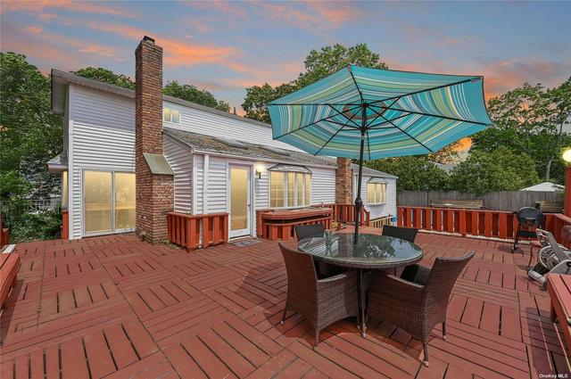 Porch featured at 42 Hurtin St, Port Jefferson Station, NY 11776