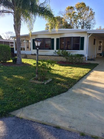 Photo of 909 Sequoia St, Barefoot Bay, FL 32976
